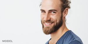Older Man Smiling after Oral Surgery